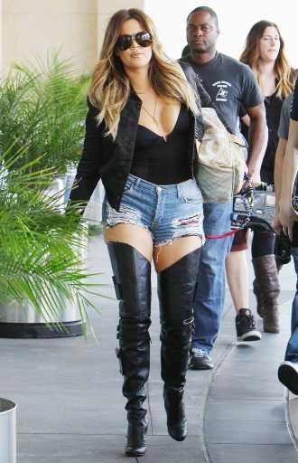 Khloe Kardashian Turns Heads in Ripped Jean Shorts and Stiletto Boots
