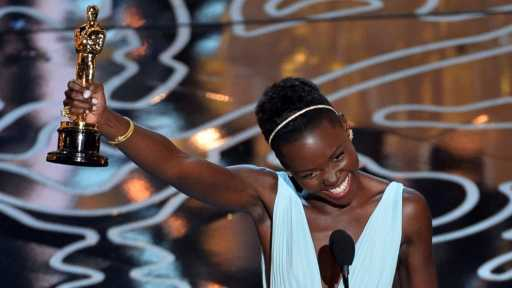 PHOTO: Actress Lupita Nyongo accepts the Best Performance by an Actress in a Supporting Role award for 12 Years a Slave onstage during the Oscars at the Dolby Theatre on March 2, 2014 in Hollywood, California.