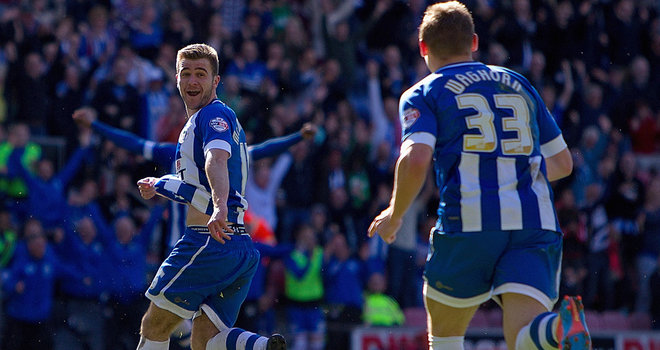 Wigan cruise as Reading fall