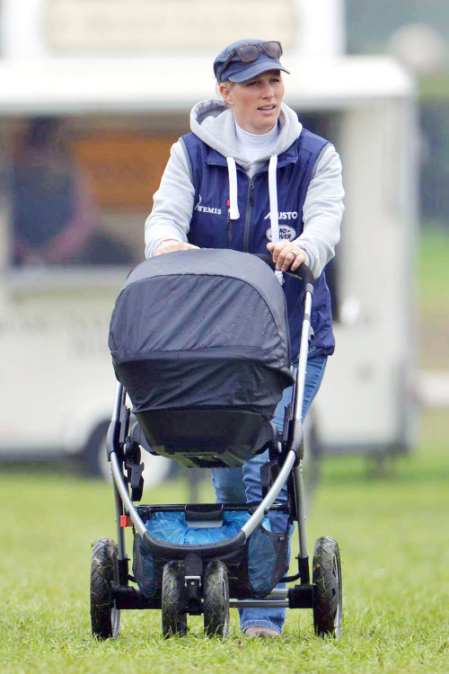 Equestrian Zara Phillips brings baby Mia to the Races **USA ONLY**