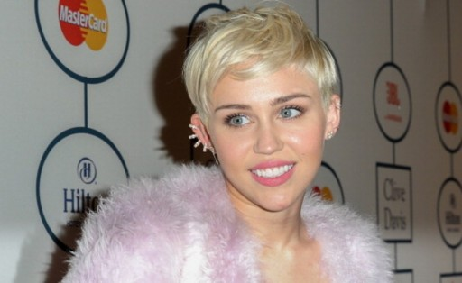 Miley Cyrus' New Tattoo Is Confusing Whether Jupiter Or Saturn